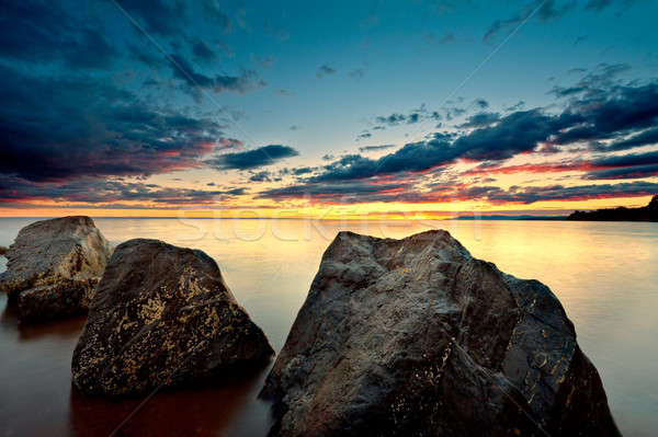 Sea at sunset with motion blur ocean Stock photo © 3523studio