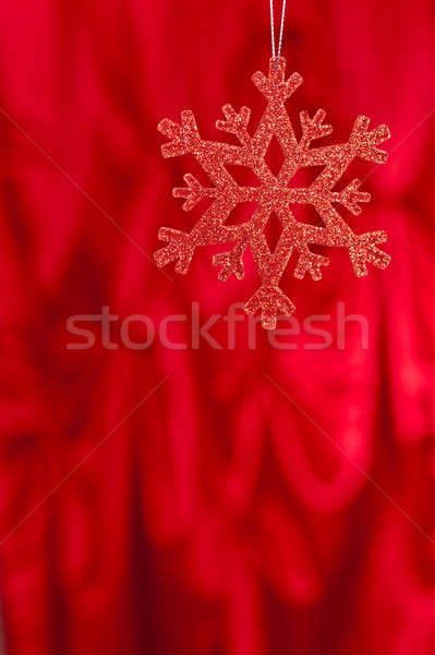 Red snow flake on a red background Stock photo © 3523studio