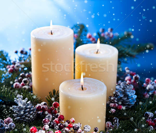 Three candles with snowfall Stock photo © 3523studio