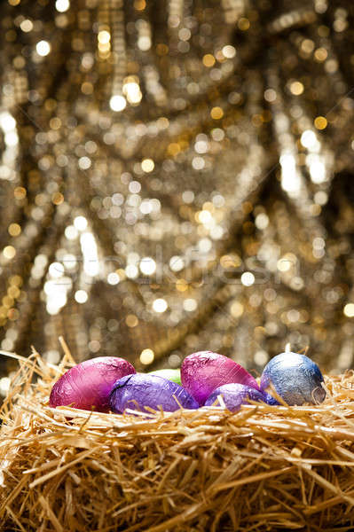 Chocolate Easter eggs in a natural straw nest Stock photo © 3523studio