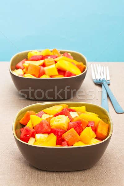 Twee kom gemengd tropische vruchten salade vork Stockfoto © 3523studio