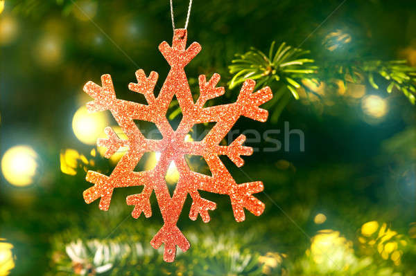 Red snow flake in a christmas tree with neon colors Stock photo © 3523studio