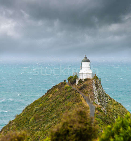 Nugget Point Light House and dark clouds in the sky Stock photo © 3523studio