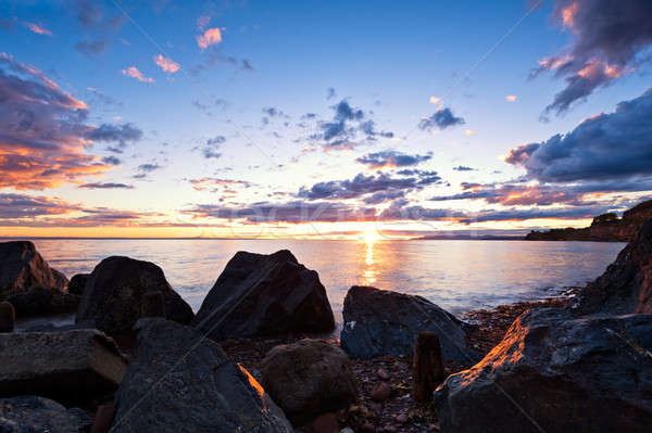 Sea at sunset, the sky is in beautiful dramatic color Stock photo © 3523studio