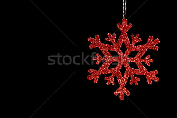 Red snow flake on a black background Stock photo © 3523studio