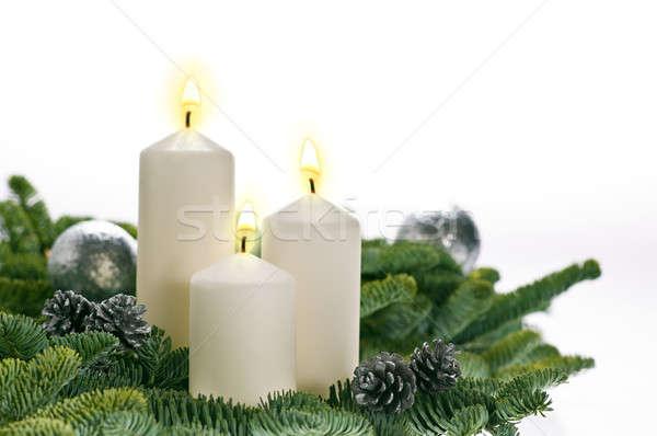 Tre candele avvento effettivo albero di natale rami Foto d'archivio © 3523studio