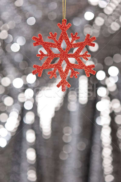 Red snow flake on a silver glitter background Stock photo © 3523studio