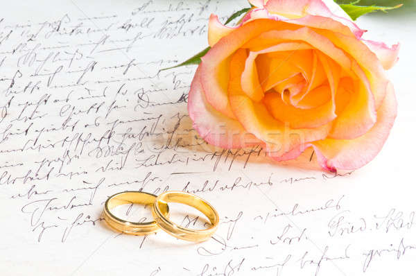 Rose and two rings over handwritten letter Stock photo © 3523studio