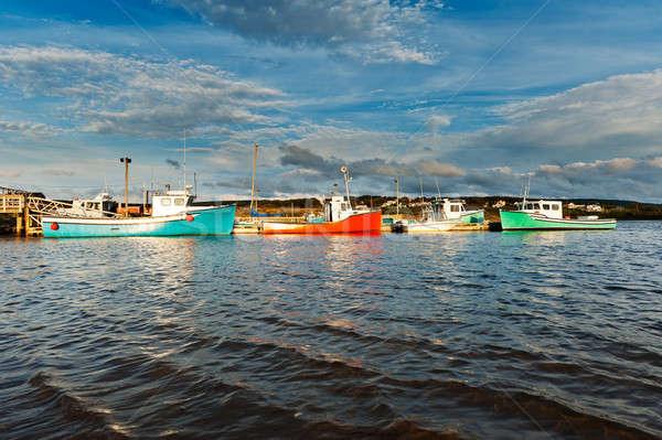 Vissersboot zonsondergang haven dramatisch hemel Blauw Stockfoto © 3523studio