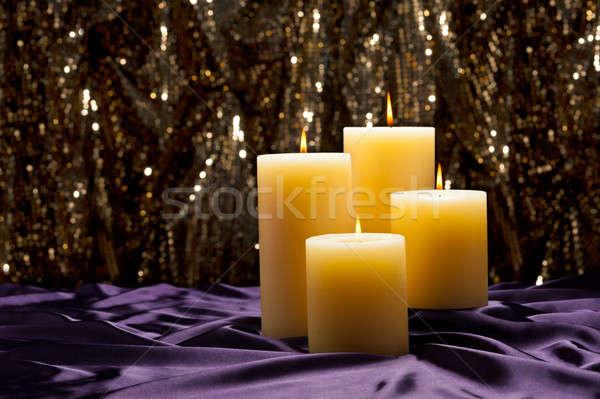 Dört mumlar mor kadife altın parıltı Stok fotoğraf © 3523studio