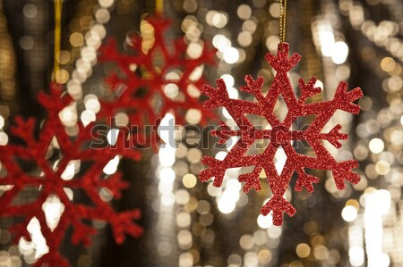 Red snow flake on a gold glitter background Stock photo © 3523studio