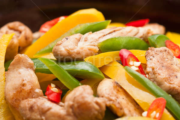 Fried Chicken with capsicum on red table cloth Stock photo © 3523studio