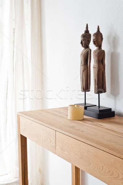 Twee buddha beeldje witte muur bloemen Stockfoto © 3523studio