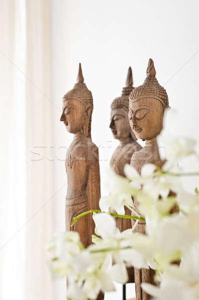 Buda figurilla blanco pared madera habitación Foto stock © 3523studio
