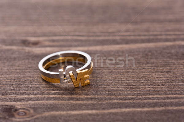 Engagement ring on wooden table Stock photo © 3523studio
