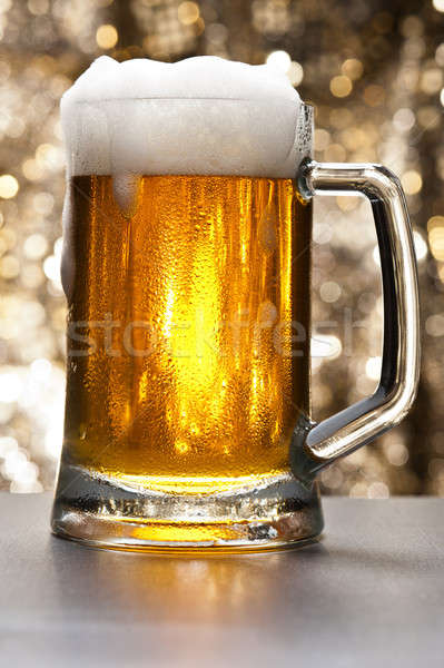 Beer mug in front of a glittering background Stock photo © 3523studio