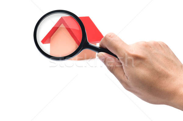 Looking with a magnifying glass on the red roofed house Stock photo © 3523studio