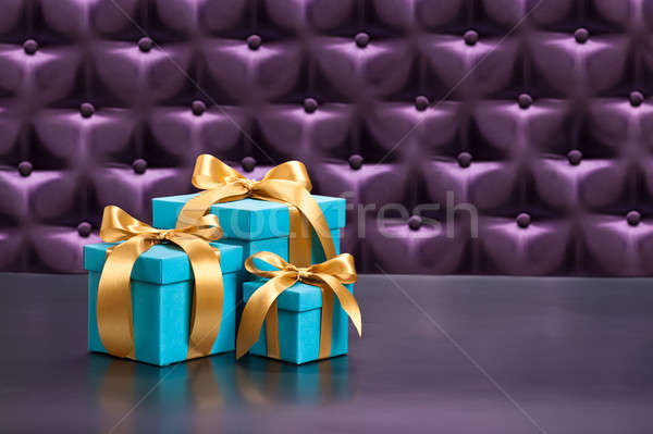 Present in front of a button tufted background Stock photo © 3523studio