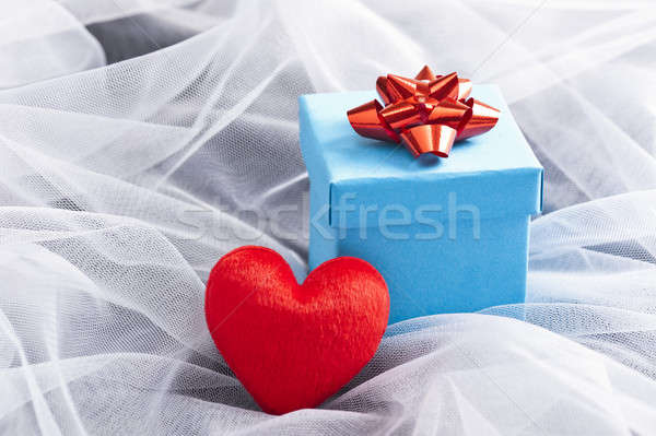 Blue Gift box with red bow on wedding veil  Stock photo © 3523studio