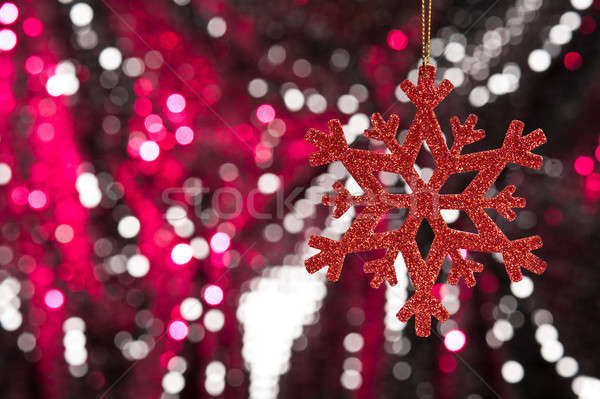 Red snow flake on a red, silver glitter background Stock photo © 3523studio