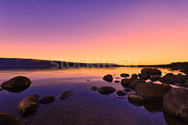 Sunset Sunrise above a lake in beautiful glowing colors Stock photo © 3523studio