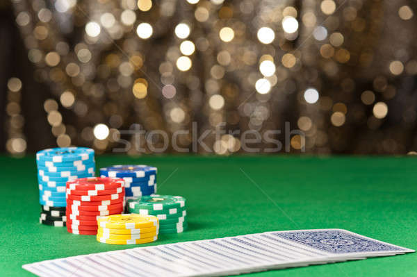 Colorful poker chips and cards Stock photo © 3523studio