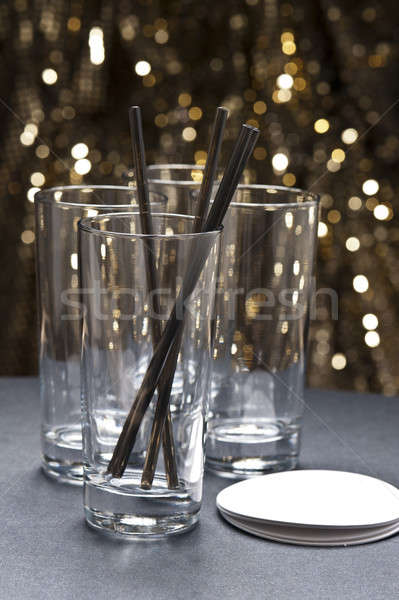 Long drink glasses with straws and coaster in front of glitter b Stock photo © 3523studio