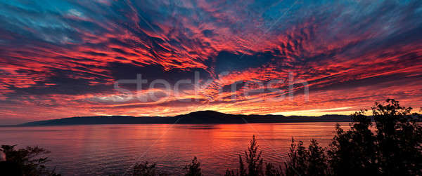 Sea at sunset, sky is in beautiful dramatic color Stock photo © 3523studio