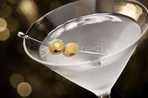 Vodka Martini with olive garnish  Stock photo © 3523studio