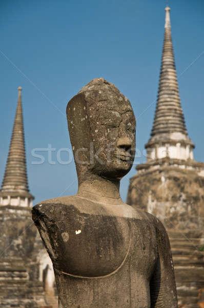 Stupa (chedi) of a Wat in Ayutthaya, Thailand, with Buddha staue Stock photo © 3523studio