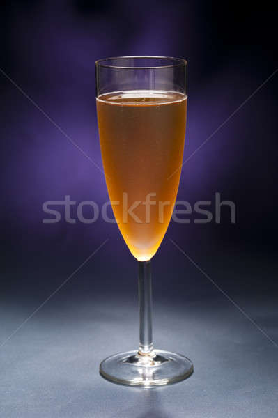 Champaign glass in front of blue purple background Stock photo © 3523studio
