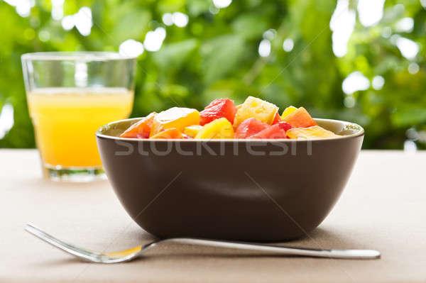 Um tigela misto fruta tropical salada natureza Foto stock © 3523studio