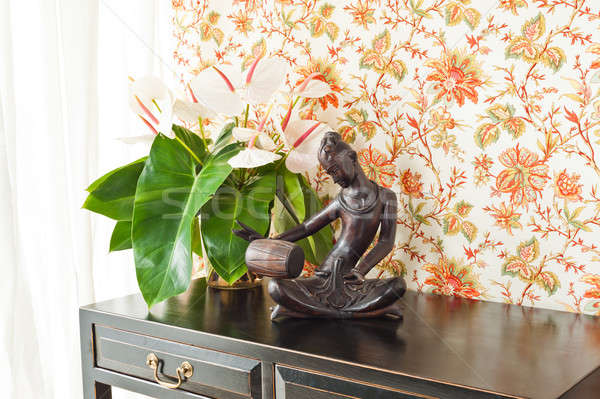Side table with flowers and interior decoration Stock photo © 3523studio