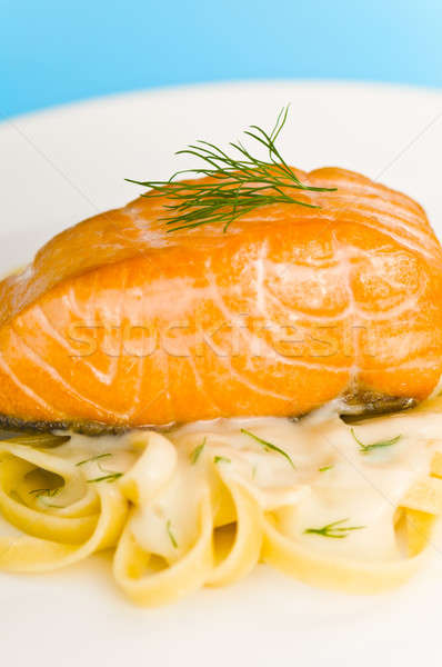 Salmon steak on pasta, decorated with dill closeup Stock photo © 3523studio