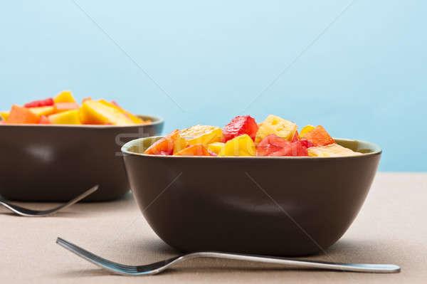 Twee kom gemengd tropische vruchten salade Blauw Stockfoto © 3523studio
