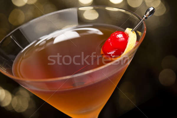 Manhattan cocktail garnished with a cherry and lemon Stock photo © 3523studio