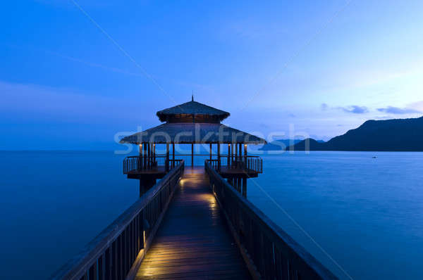 Building at the end of a jetty during twilight Stock photo © 3523studio