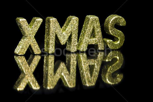 Hoofdletter geschreven kerstmis schitteren effect zwarte Stockfoto © 3523studio