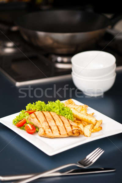 Chicken, French fries and salad Stock photo © 3523studio