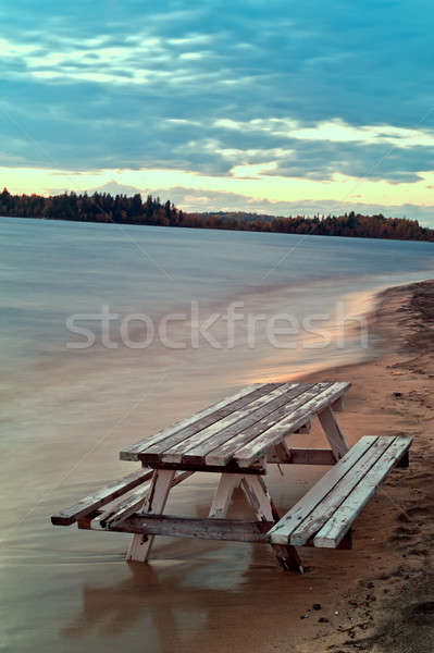 Bench and table sunk into the sand  Stock photo © 3523studio