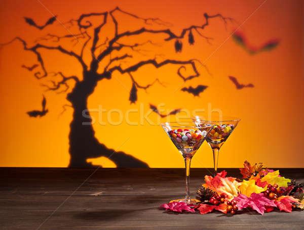 Sweets in Halloween setting with tree Stock photo © 3523studio
