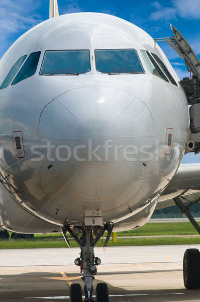 Closeup of airplane nose with pilot cabin against blue sky Stock photo © 3523studio