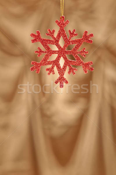 Red snow flake on a gold background Stock photo © 3523studio