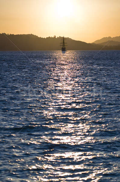 sailboat bathed in dawn sunlight  Stock photo © 3523studio