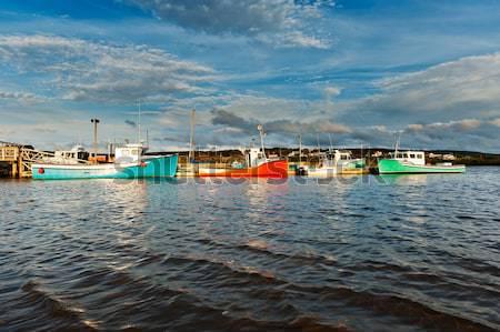 Halászhajók naplemente kikötő drámai égbolt kék Stock fotó © 3523studio