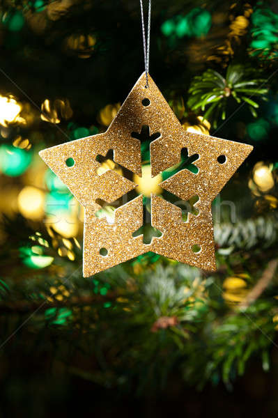Decorativo oro star ornamento albero di natale party Foto d'archivio © 3523studio
