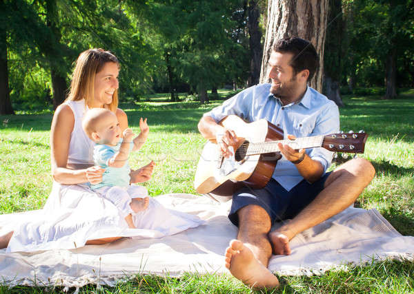 Happy young family spending time outdoor on a summer day Stock photo © 3dvin