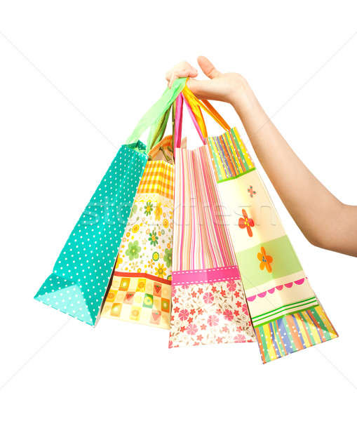 Female hand holding shopping bags, isolated Stock photo © 3dvin
