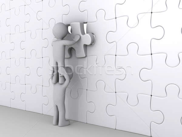 Person on top of another putting last piece of puzzle Stock photo © 6kor3dos