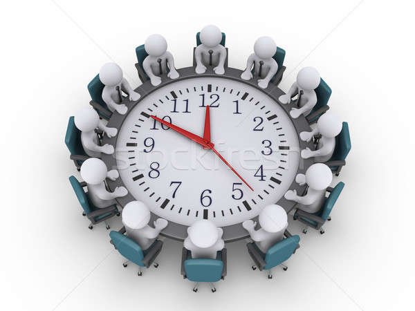 Meeting of businessmen around a clock-table Stock photo © 6kor3dos